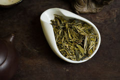 Chinese tea leaves macro. Chinese tea pile in a cup closeup Royalty Free Stock Photos