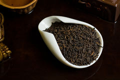 Tea chinese pile in cup. Chinese tea pile in a cup closeup Royalty Free Stock Photography