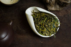 Tea leaves in a cup. Chinese tea pile in a cup closeup Royalty Free Stock Photos