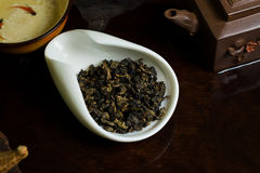Tea in cup. Chinese tea pile in a cup closeup Royalty Free Stock Images