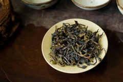 Pile of tea leaves on cup. Chinese tea pile in a cup closeup Stock Image
