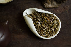 Tea in white cup. Chinese tea pile in a cup closeup Royalty Free Stock Photos