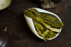 Long chinese tea leaves in cup dry. Chinese tea pile in a cup closeup Royalty Free Stock Photos