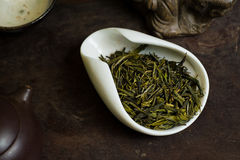 Tea leaves pile in cup. Chinese tea pile in a cup closeup Stock Photos