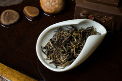 Tea in cup dry. Chinese tea pile in a cup closeup Stock Image