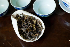 Tea pile macro. Chinese tea pile in a cup closeup Royalty Free Stock Image