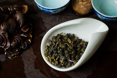 Tea chinese in cup dry. Chinese tea pile in a cup closeup Royalty Free Stock Images