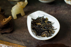 Tea leaves pile in cup closeup. Chinese tea pile in a cup closeup Stock Photography