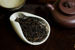Tea leaves in cup. Chinese tea pile in a cup closeup Royalty Free Stock Image
