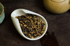 Tea in cup closeup. Chinese tea leaves in cup closeup Stock Image