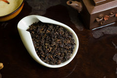 Tea leaves pile in cup. Chinese tea in  cup closeup Royalty Free Stock Photos