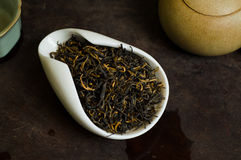 Tea chinese pile. Chinese tea in cup closeup Royalty Free Stock Photography