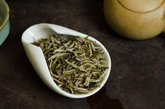 Chinese tea in cup. Chinese tea pile in cup closeup Royalty Free Stock Images