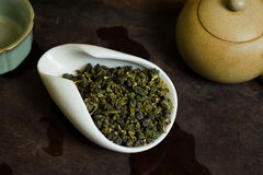 Tea in white cup. Chinese tea pile closeup Stock Image