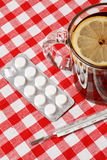 Tea,pills and thermometer Stock Image