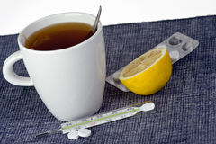 Tea,pills and thermometer Royalty Free Stock Photography