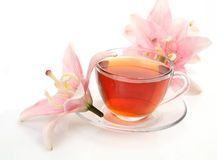 Tea and pink lilies Royalty Free Stock Photo