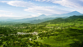 Tea plantation highlands and village. Aerial view of tea plantation highlands with village and mountain view. Shot at Subang highlands, Indonesia stock photography