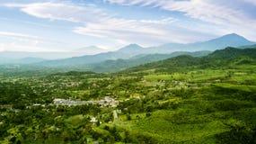 Tea plantation highlands and village. Aerial view of tea plantation highlands with village and mountain view. Shot at Subang highlands, Indonesia Stock Photography