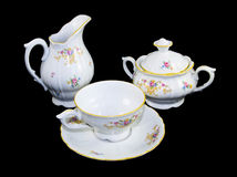 Tea porcelain set. Cap, sugar-box and mug Royalty Free Stock Photography