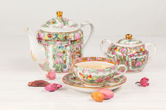 Tea and porcelain set on the table Stock Images