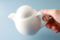 Tea pot. On a blue bg Royalty Free Stock Photography