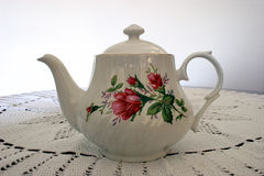 Tea Pot. This is a tea pot sitting on a crocheted lace tablecloth Stock Image