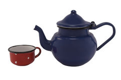 Tea pot. Dark blue tea pot and red tea cup against white background stock images