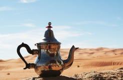 Tea pot. In Sahara desert Royalty Free Stock Image