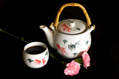 Tea and Pot. Chinese tea and teapot with flowers Royalty Free Stock Image