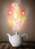 Tea pot with abstract steam and colorful lights Royalty Free Stock Photography