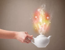 Tea pot with abstract steam and colorful lights Stock Image