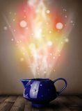 Tea pot with abstract steam and colorful lights Royalty Free Stock Photos
