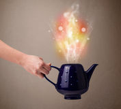 Tea pot with abstract steam and colorful lights Royalty Free Stock Images