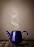 Tea pot with abstract white steam Royalty Free Stock Images