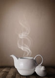 Tea pot with abstract white steam Royalty Free Stock Photos