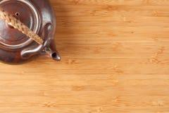Tea Pot and Bamboo Textured Surface Stock Photography