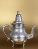 Tea pot. Beautiful tea pot on the golden background Royalty Free Stock Image