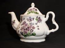 Tea pot on black background Royalty Free Stock Images