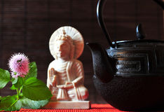 Tea pot Buddha Stock Photo