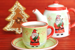 Tea pot, candy fir and cup with Christmas ornament Stock Photos