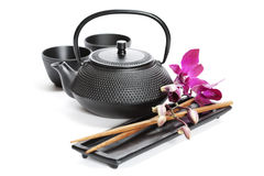 Tea pot and chopsticks Royalty Free Stock Photos
