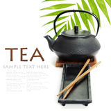 Tea pot and chopsticks Royalty Free Stock Image