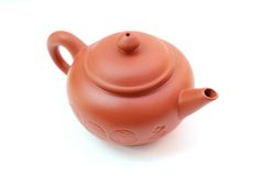 Tea pot. The clay tea pot, yixing, is isolated on wihte background Stock Image