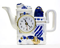 Tea pot with a clock. Tea pot in white and blue colours of original design with a clock Royalty Free Stock Photo