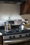 Tea pot and coffee pot on stove Stock Photos