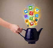 Tea pot with colorful media icons Stock Images