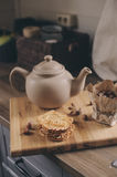 Tea pot and cookies in rustic grey kitchen interior. Slow living in country house concept Royalty Free Stock Photos
