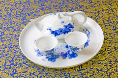 Tea pot and cup. S with a blue-and-white pattern Stock Images