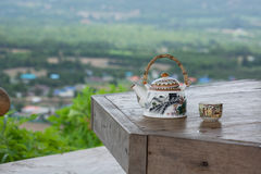Tea pot and cup with beautiful background. Tea pot and cup with beautiful view Stock Photos